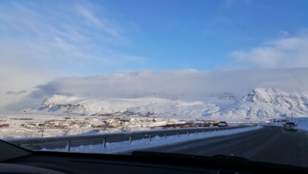 Check out the way the clouds sit on top of the mountains north of Reykjavik.